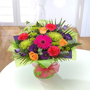 Vibrant bouquet of flowers created by Designer Flowers by Chris